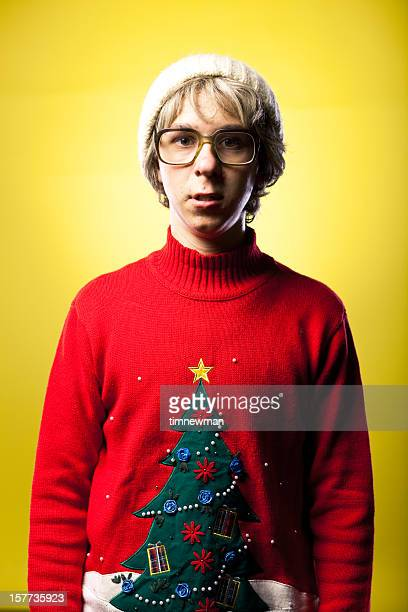 surprised or nervous looking christmas holiday nerd boy wearing sweater - naughty santa stock photos and pictures
