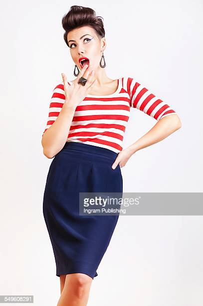 Surprised pin up girl in t-shirt and skirt