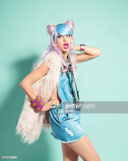 surprised pink hair girl in funky manga outfit - crazy holiday models stock photos and pictures