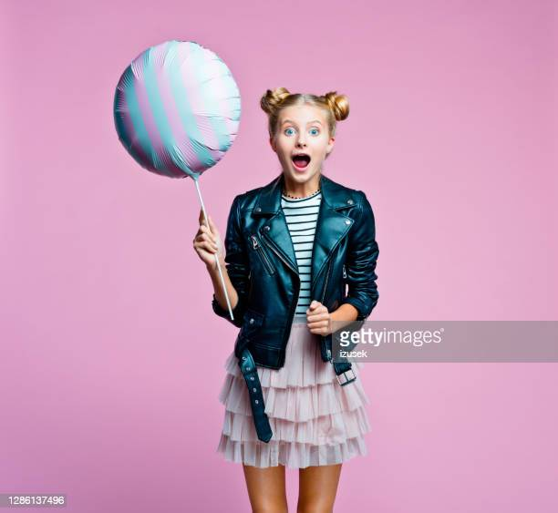 surprised teenege girl holding big balloon - embellished jacket stock pictures, royalty-free photos & images