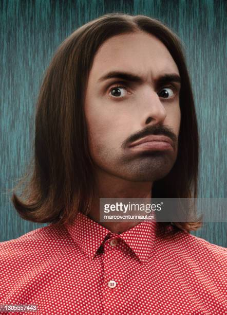surprised weird man, portrait in studio in retro style - marcoventuriniautieri stock pictures, royalty-free photos & images