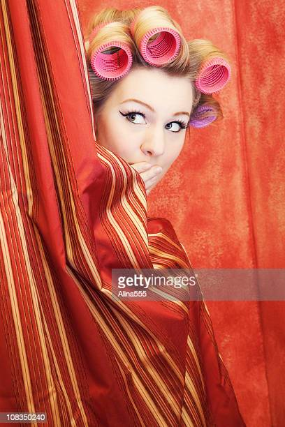 Surprised woman in a shower wearing rollers - pinup style