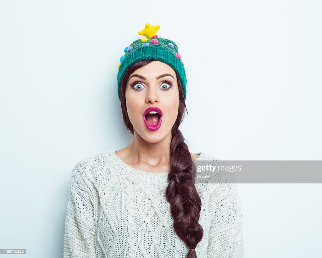 Surprised woman in winter outfit : Stock Photo