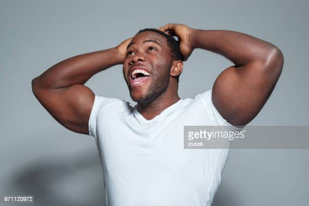 surprised young african american man - black male bodybuilders stock photos and pictures