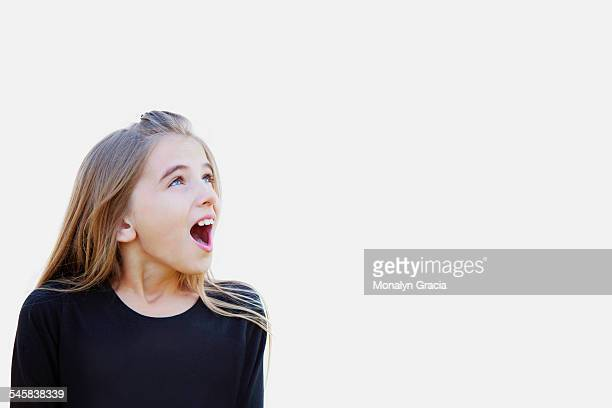 surprised young girl - girls open mouth stockfoto's en -beelden