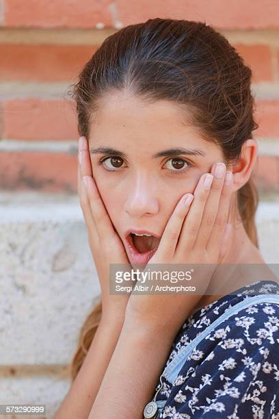 Surprised young girl.