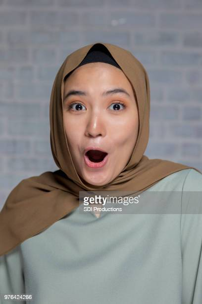surprised young woman - malaysian ethnicity stock pictures, royalty-free photos & images