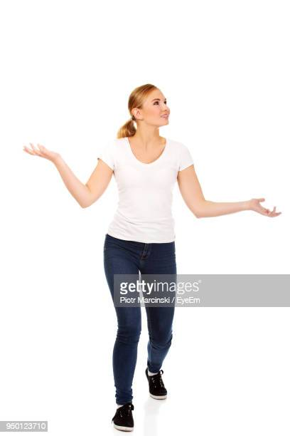 Surprised Young Woman Standing Against White Background