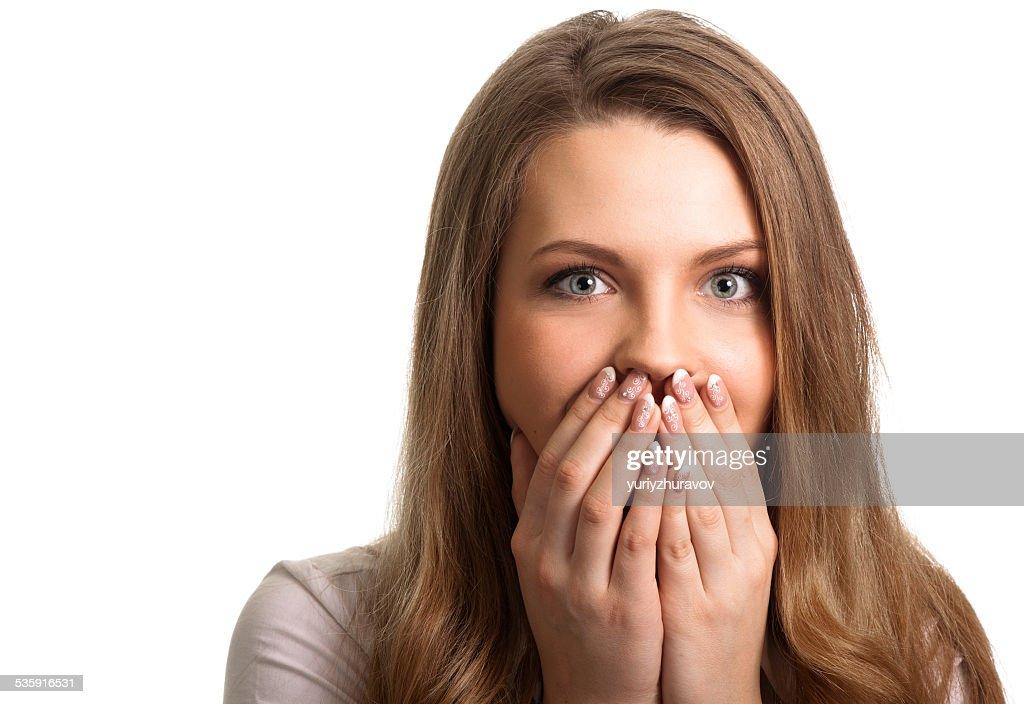 Surpresa Jovem mulher com as mãos sobre a Boca : Foto de stock