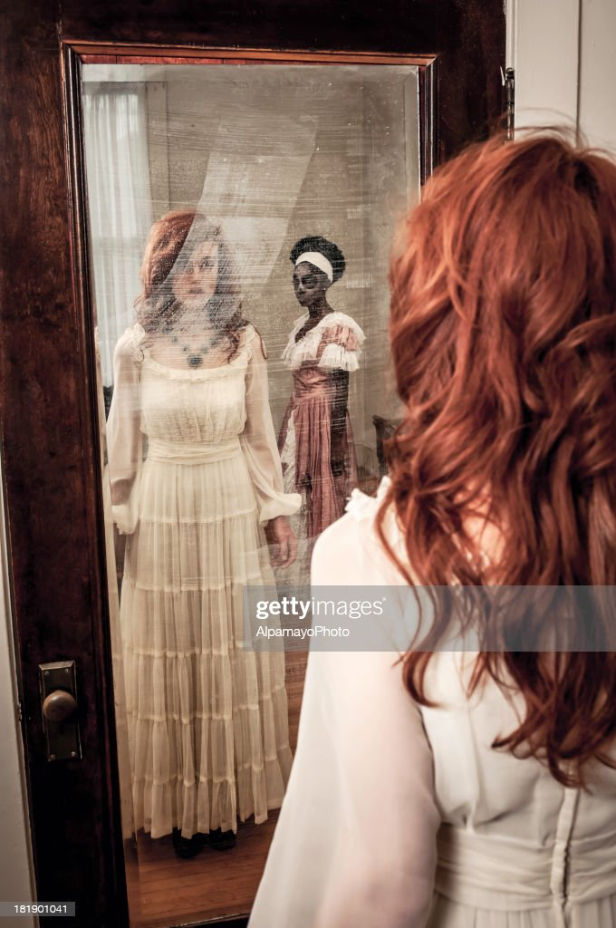 Surprising ghostly reflection in the mirror : Stock Photo