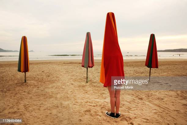 surreal beach scene - spectacles stock pictures, royalty-free photos & images