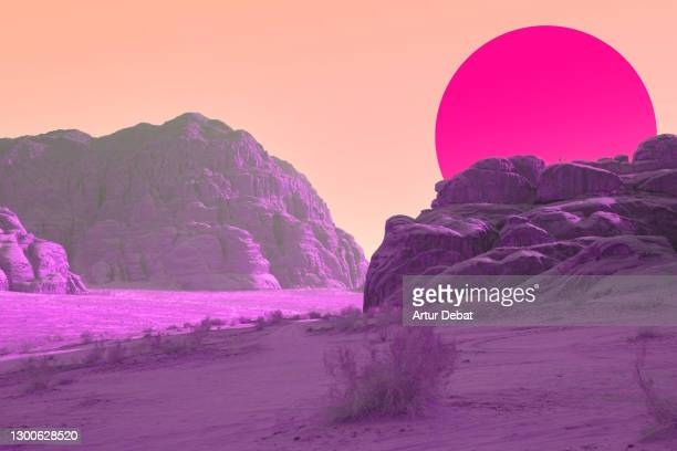 surreal colorful landscape with vivid colors and big sunset sun. - desert stock pictures, royalty-free photos & images