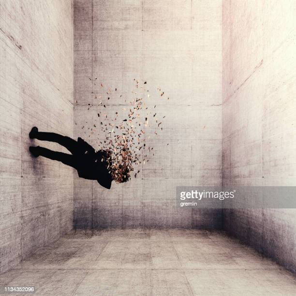 surreal exploding businessman - disintegration stock photos and pictures