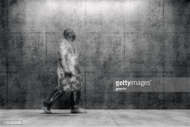surreal exploding businessman walking - disintegration stock photos and pictures