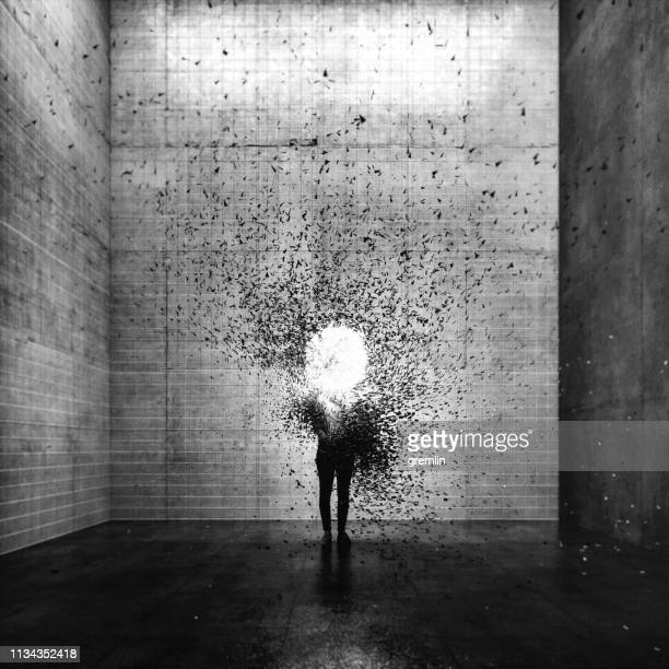 surreal exploding young woman - disintegration stock photos and pictures