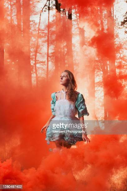 surreal girl in the smoke in a fancy blue forest fairy - bottomless girl stock pictures, royalty-free photos & images