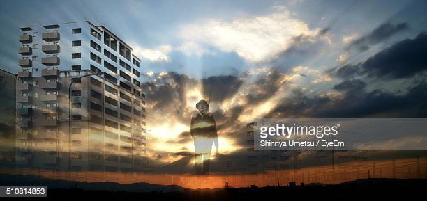 Surreal image of a lone man walking through a cloudscape