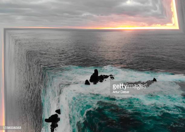 surreal ocean view from aerial view bending the seascape creating stunning effect. - surrealista fotografías e imágenes de stock