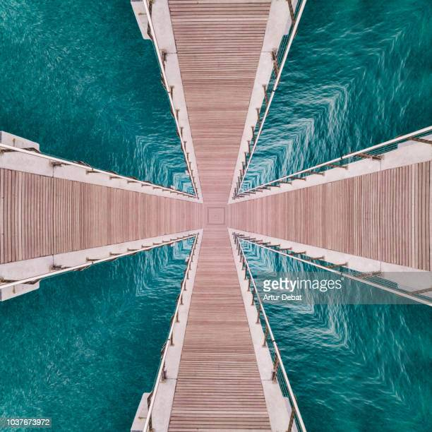 surreal picture of repetition landscape with nice symmetry and vanishing point. - elevated walkway stock pictures, royalty-free photos & images