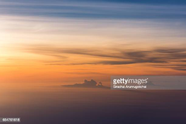 Surreal scenery over clouds during flight