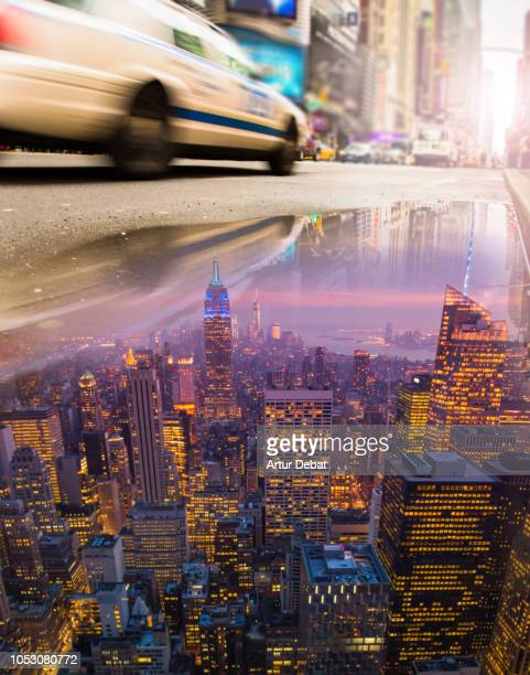surreal street of manhattan with city skyline reflected on the puddle. - colour manipulation stock pictures, royalty-free photos & images