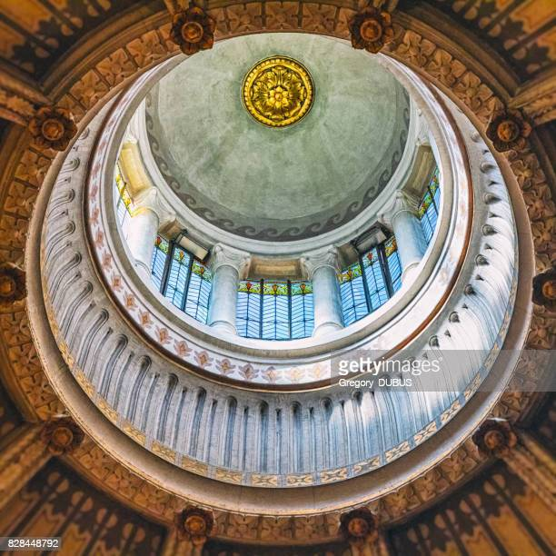 Surreal view of geometric shapes of cupola ceiling architecture of french Ars-Sur-Formans Basilica famous religious church for pilgrims