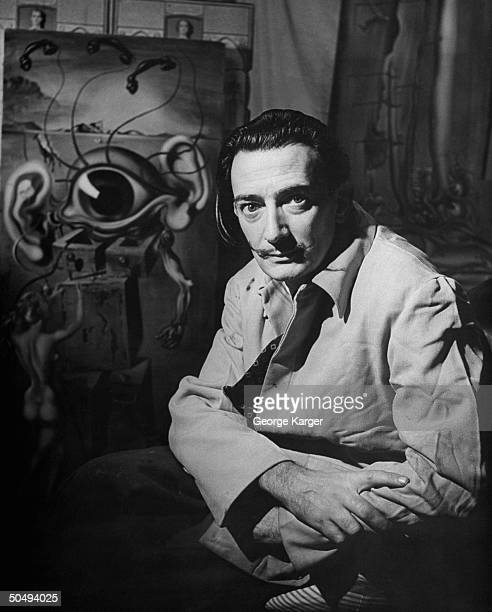 Surrealist artist Salvador Dali posing w his oil painting entitled Movies one of a series called Seven Lively Arts at his studio on the 8th floor of...