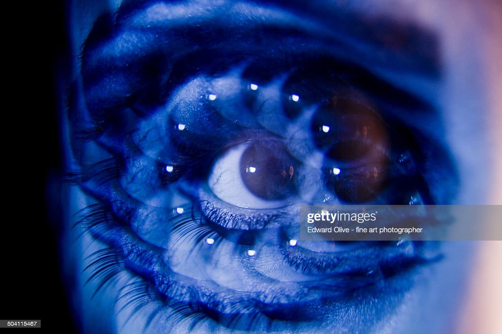 Surrealist multiple image of young lady's eye : Foto de stock