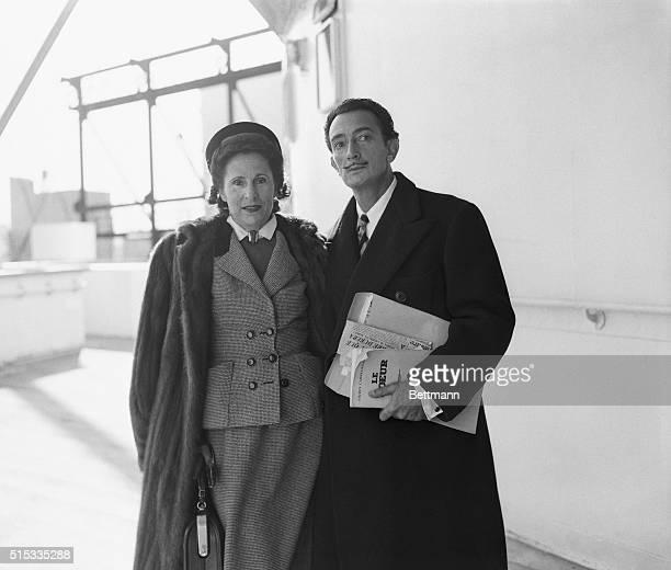 Surrealist Salvador Dali and his wife Gala arrive on the Liberte 11/10