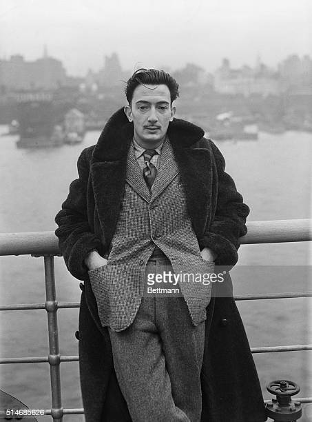 Surrealist Salvador Dali stands on the deck of the SS Normandie as it docks in New York City