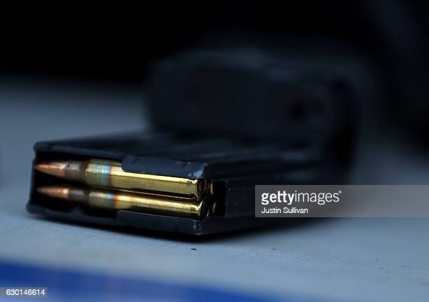 A surrendered assault rifle magazine with bullets sits on a table during a gun buyback event on December 17 2016 in San Francisco California Dozens...