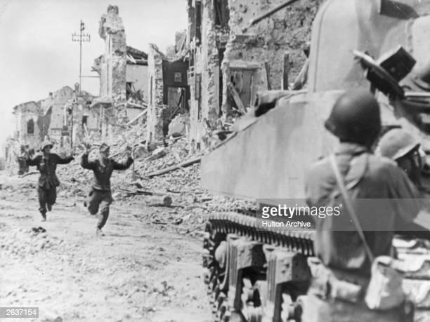 Surrendering German soldiers run towards Allied lines at Cisterna.