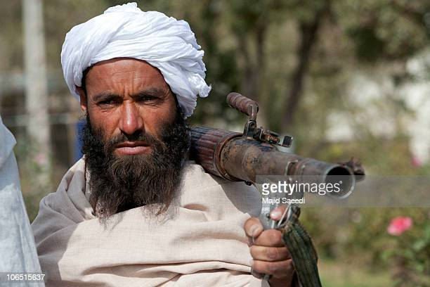Surrendering Taliban militants stand with their weapons as they are presented to the media on November 4, 2010 in Herat, Afghanistan. Twenty Taliban...