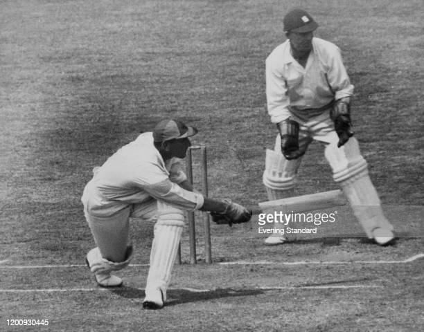 Surrey batsman Douglas Jardine swipes a loose ball from Jarrett to the boundary on the third and last day of a County Championship match against...