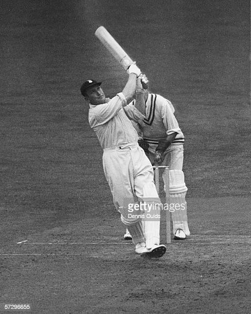 Surrey batsman Jim Laker hits a four from Jimmy Gray of Hampshire at the Oval London 5th August 1953