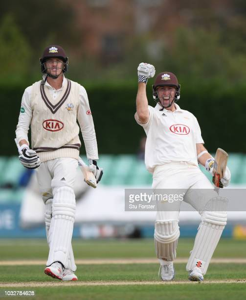 Surrey batsmen Morne Morkel and Rikki Clarke celebrate after Surrey had won the match to win the 2018 Championship after day four of the Specsavers...