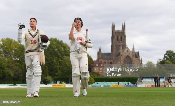 Surrey batsmen Morne Morkel and Rikki Clarke leave the field together after Surrey had won the match to win the 2018 Championship after day four of...