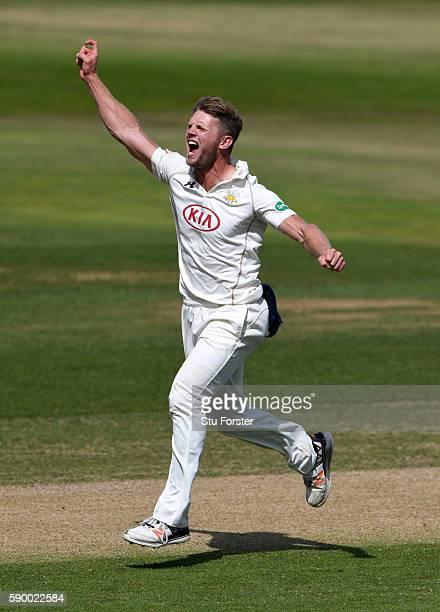 Surrey bowler Stuart Meaker celebrates after dismissing Warwickshire batsman Jonathan Trott for 9 runs during day 4 of the Specsavers Division One...
