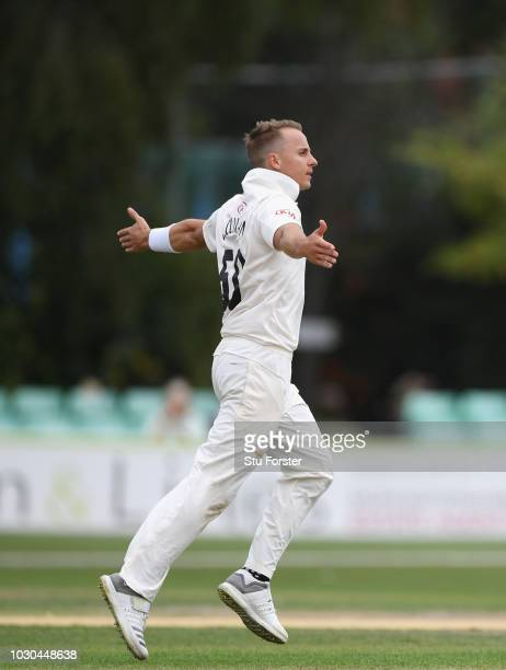 Surrey bowler Tom Curran celebrates after bowling Westbury during day one of the Specsavers County Championship Division One match between...