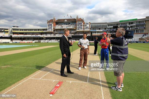 Surrey Brown Caps' Mark Ramprakash and Essex Eagles' join Sky Sports presenter on the crease for the coin toss