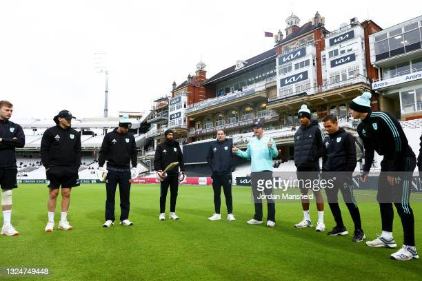Surrey Captain Gareth Batty talks to his plays ahead of the start of play during the Vitality T20 Blast match between Surrey and Essex Eagles at The...