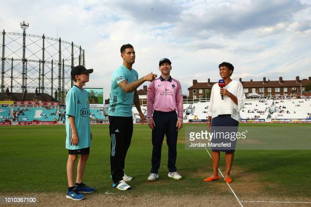 Surrey Captain Jade Dernbach and Middlesex Captain Eoin Morgan perform the toss prior to the start of the Vitality Blast match between Surrey and...