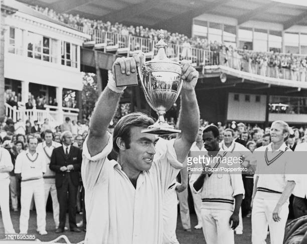 Surrey captain John Edrich is presented with the Benson and Hedges Cup after Surrey won the Benson and Hedges Cup Final between Leicestershire and...