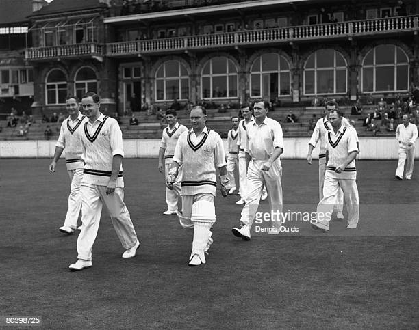 Surrey captain Peter May leading out his team the county champions at The Oval 29th August 1958
