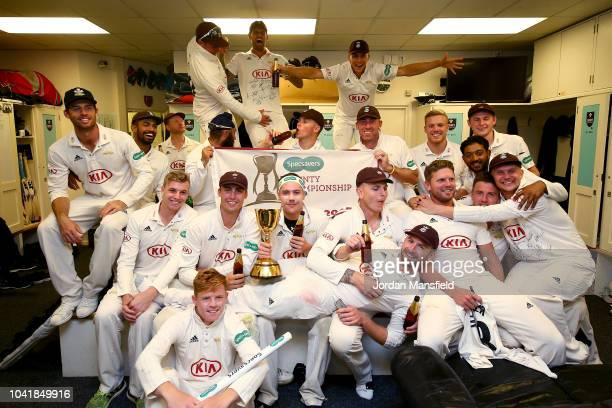 Surrey Captain Rory Burns celebrates with his teammates after winning the Specsavers County Championship during day four of the Specsavers County...