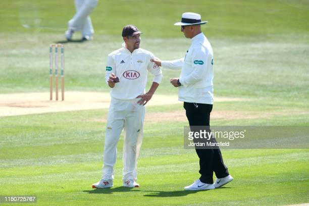Surrey captain Rory Burns discusses the state of the ball with the umpire during day two of the Specsavers County Championship Division One match...