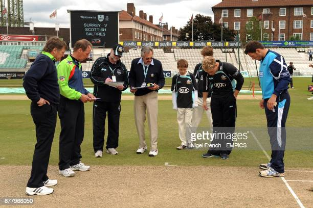 Surrey captain Rory HamiltonBrown at the coin toss with Scotland captain Gordon Drummond and match umpires Trevor Jesty and Jeremy Lloyds