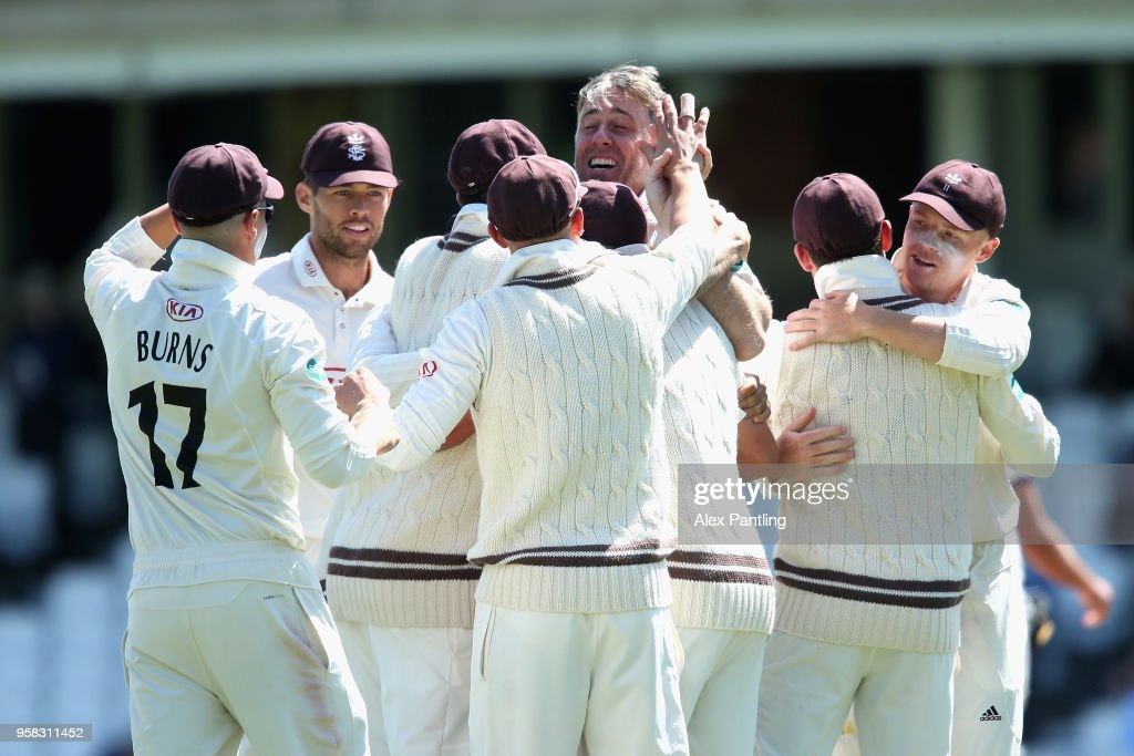 Surrey celebrate victory during day four of the Specsavers County Championship Division One match between Surrey and Yorkshire at The Kia Oval on May 14, 2018 in London, England.