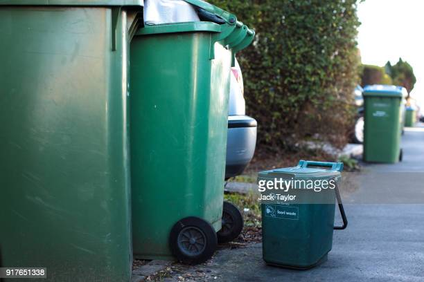 Surrey council wheelie bins and a food waste bin stand out on a residential street on February 12, 2018 in Weybridge, United Kingdom. Surrey County...