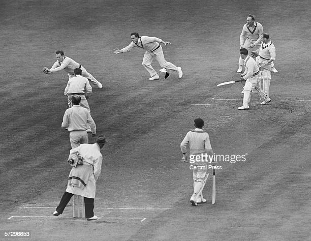 Surrey cricketer Jim Laker catches out Roy Smith of Somerset from a ball by Lock at the Oval London 16th May 1955